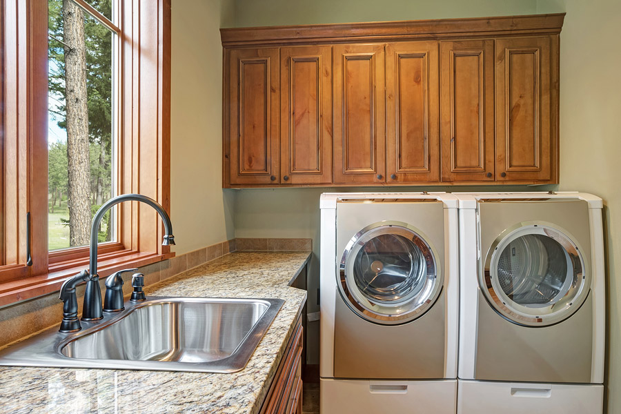 Huge Laundry Room With White Washing Machine Installed