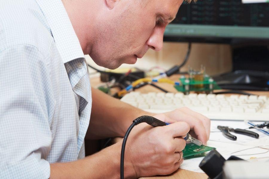 Guy soldering board